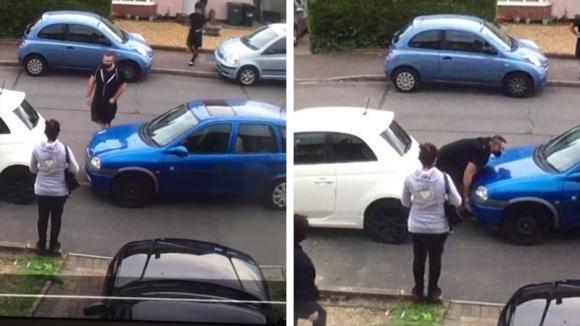 Un'auto parcheggiata male gli impedisce di uscire dal garage. La reazione dell'uomo è epica!