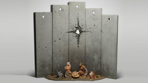 Banksy: nel presepe di Betlemme la stella cometa è il buco lasciato da una granata