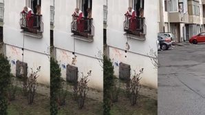 Coronavirus, cani calati col guinzaglio dai balconi per la passeggiata: sul web è polemica