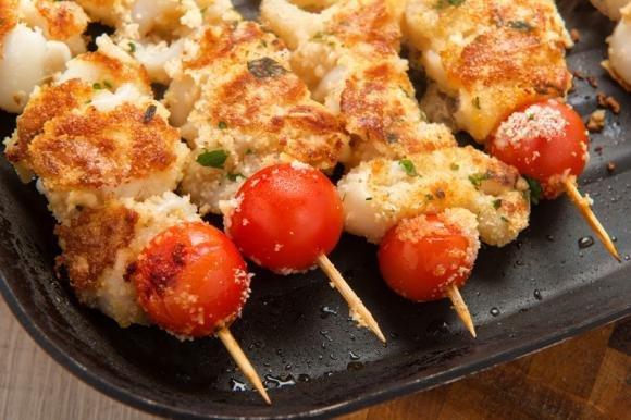 Spiedini di pesce gratinati al forno