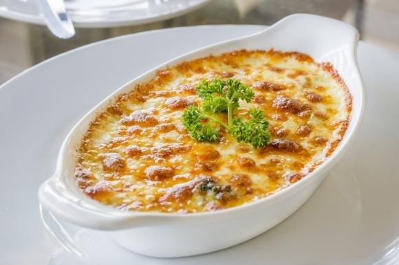 Spinaci gratinati con prosciutto e formaggio