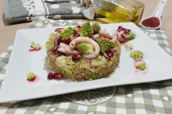 Quinoa con broccoli e calamari