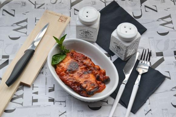 Parmigiana di zucchine grigliate con groviera e acciughe