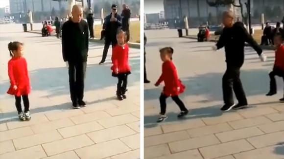 Un nonno si esibisce con le sue nipotine. Il loro simpatico balletto è ipnotico