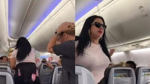 Paura a bordo: donna picchia furiosamente il marito. Un passeggero riprende la scena scioccante!