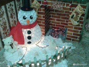 Pupazzo di neve con bicchieri